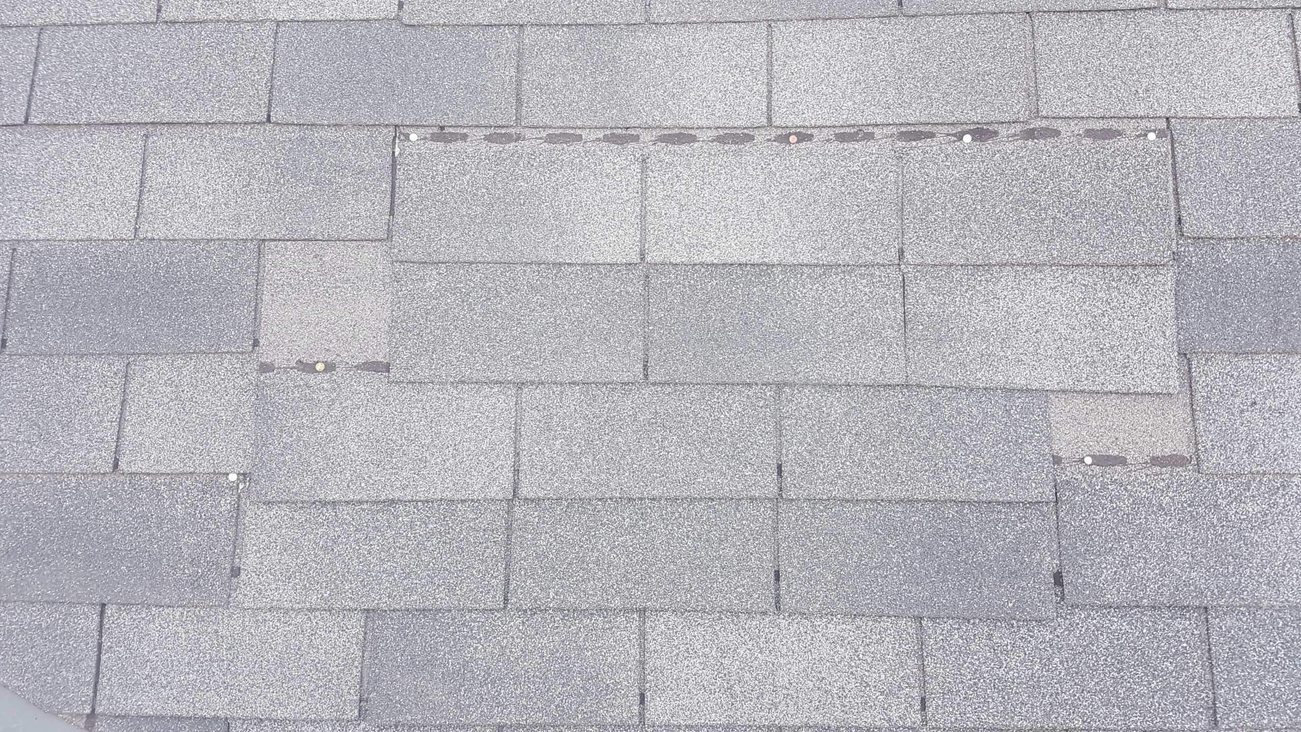 Improperly patched shingles